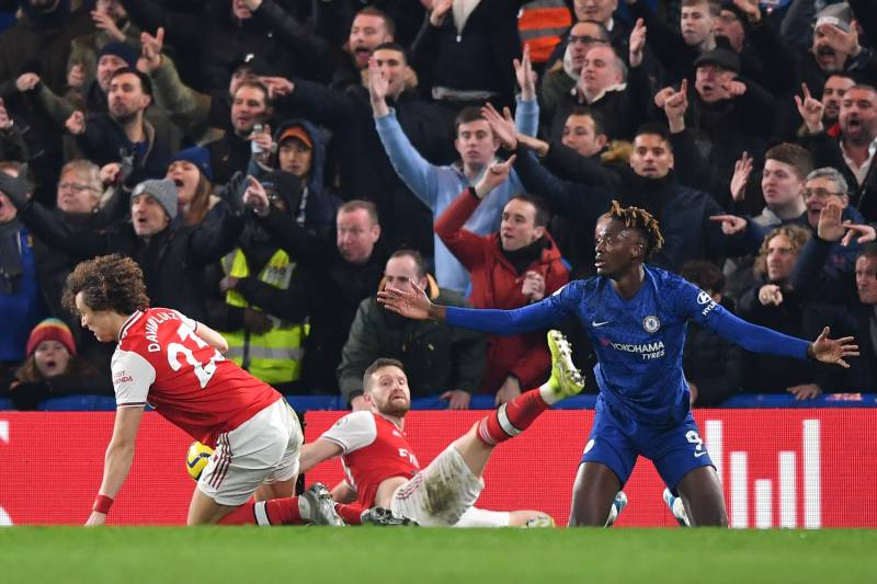 Chelsea's English striker Tammy Abraham (R) appeals after being fouled by Arsenal's Brazilian defender David Luiz (L) to win a penalty during the English Premier League football match between Chelsea and Arsenal at Stamford Bridge in London on January 21,