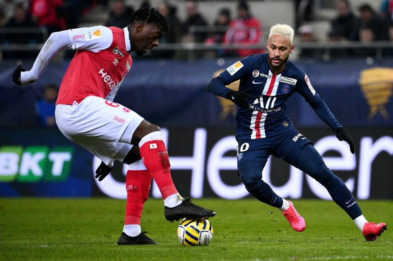 Paris Saint-Germain's Brazilian forward Neymar (R) and Reims' French defender Axel Disasi vie for the ball during the French League Cup semi-final football match between Stade de Reims and Paris Saint-Germain at the Auguste Delaune Stadium in Reims on Jan