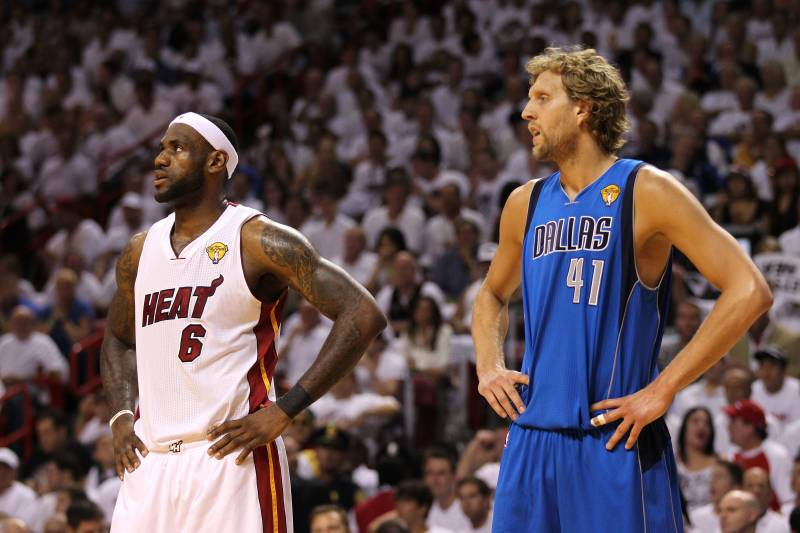 MIAMI, FL - JUNE 12: (L-R) LeBron James #6 of the Miami Heat and Dirk Nowitzki #41 of the Dallas Mavericks look on in Game Six of the 2011 NBA Finals at American Airlines Arena on June 12, 2011 in Miami, Florida. The Mavericks won 105-95. NOTE TO USER: User expressly acknowledges and agrees that, by downloading and/or using this Photograph, user is consenting to the terms and conditions of the Getty Images License Agreement.  (Photo by Mike Ehrmann/Getty Images)