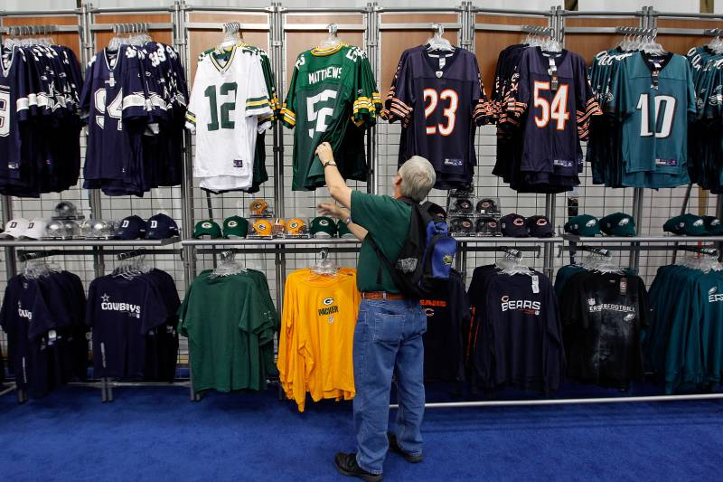 ebdb85c6807 DALLAS, TX - JANUARY 29: Mike Welch shops for officially licensed NFL  merchandise at