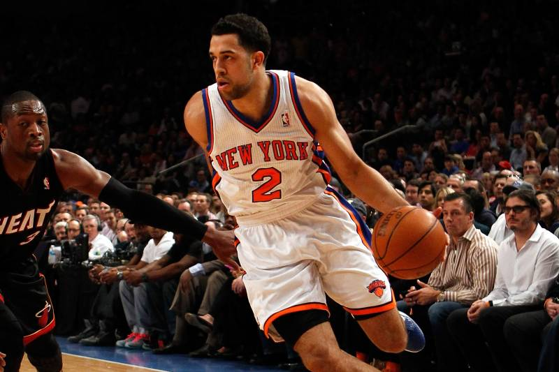 NEW YORK, NY - MAY 06:  Landry Fields #2 of the New York Knicks drives against Dwyane Wade #3 of the Miami Heat in Game Four of the Eastern Conference Quarterfinals in the 2012 NBA Playoffs on May 6, 2012 at Madison Square Garden in New York City. NOTE TO USER: User expressly acknowledges and agrees that, by downloading and or using this photograph, User is consenting to the terms and conditions of the Getty Images License Agreement  (Photo by Jeff Zelevansky/Getty Images)