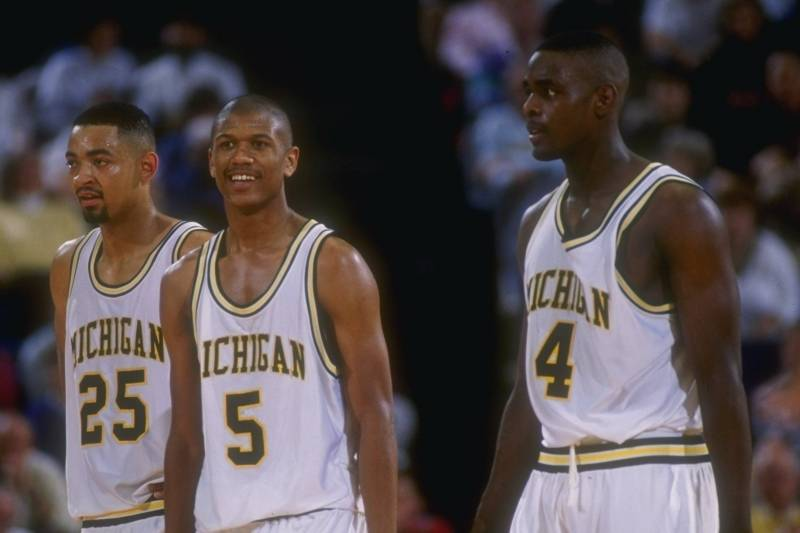 8 Mar 1992: Michigan Wolverines forward Juwan Howard, guard Jalen Rose, and forward Chris Webber (l to r) look on during a game against the Indiana Pacers.