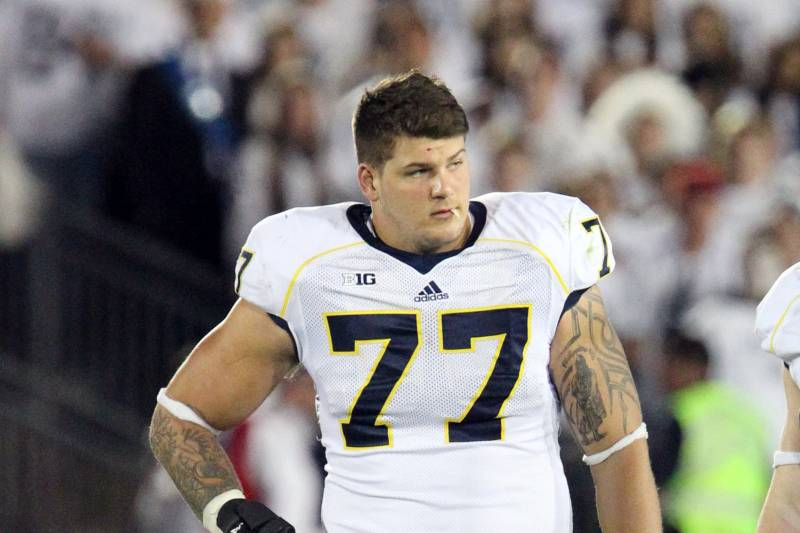 the best attitude 07739 31fd1 Big Ten Reportedly Will Not Punish Michigan's Taylor Lewan ...