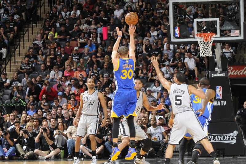 SAN ANTONIO, TX - MAY 6: Stephen Curry #30 of the Golden State Warriors shoots a three pointer against Cory Joseph #5 of the San Antonio Spurs in Game One of the Western Conference Semifinals during the 2013 NBA Playoffs on May 6, 2013 at the AT&T Center in San Antonio, Texas. NOTE TO USER: User expressly acknowledges and agrees that, by downloading and or using this photograph, user is consenting to the terms and conditions of the Getty Images License Agreement. Mandatory Copyright Notice: Copyright 2013 NBAE (Photos by D. Clarke Evans/NBAE via Getty Images)
