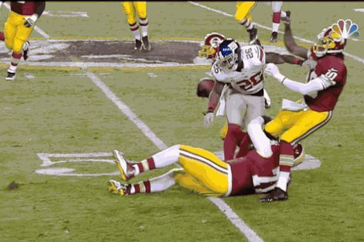 Robert Griffin III Gets Knocked Down While Trying to Block