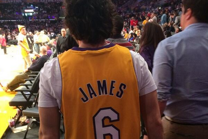 5463f1c57e58 Courtside Fan Wears Custom LeBron James Lakers Jersey in Clever Recruiting  Ploy