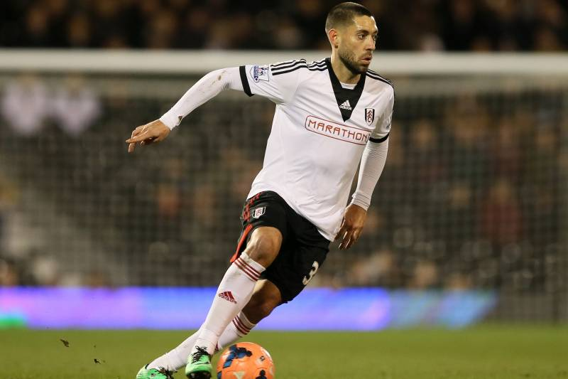 5255c5efe48 Fulham s Clint Dempsey takes the ball forward during their 4th round replay  English FA Cup soccer