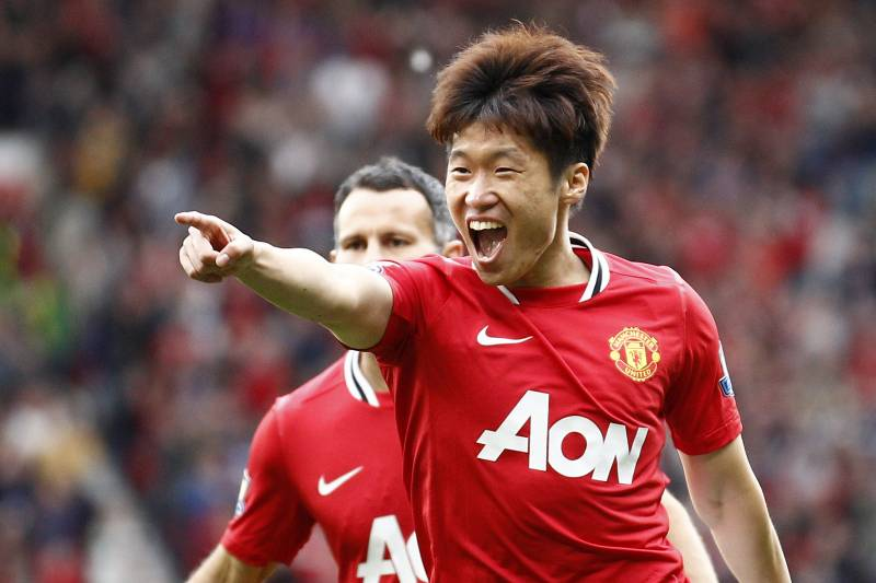 1835e75a9 Manchester United s Ji-Sung Park celebrates with team mate Ryan Giggs after  scoring a goal