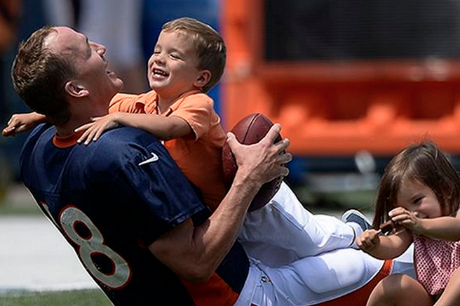 Peyton Manning Gets Tackled By His Son At Training Camp Bleacher