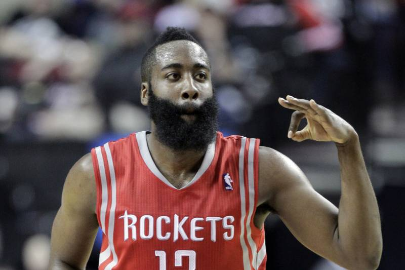 f1685d13e1e9 Houston Rockets guard James Harden flashes three fingers after scoring a  three point shot during the