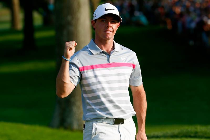 AKRON, OH - AUGUST 03: Rory McIlroy of Northern Ireland celebrates after his winning