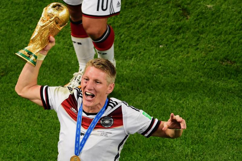 e4cc470c0 Germany s Bastian Schweinsteiger holds up the trophy as he celebrates after  the World Cup final soccer