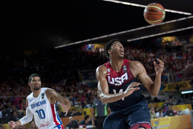 buy popular 0e6e6 21f1e Anthony Davis of the US, right, tries to control the ball in front as