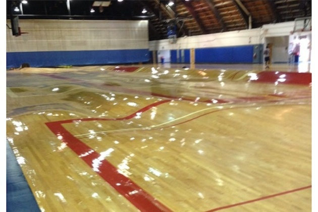 Pipes Burst Underneath Basketball Court Warping Wood To The Extreme
