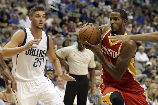 c9a42ce5c3e8 Rockets forward Trevor Ariza drives on the Mavericks  Chandler Parsons