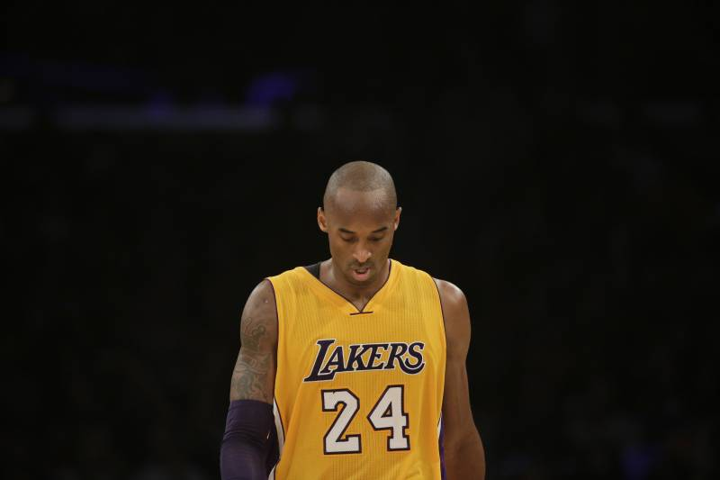 afcba4338ef Los Angeles Lakers' Kobe Bryant walks along the court during the second  half of an