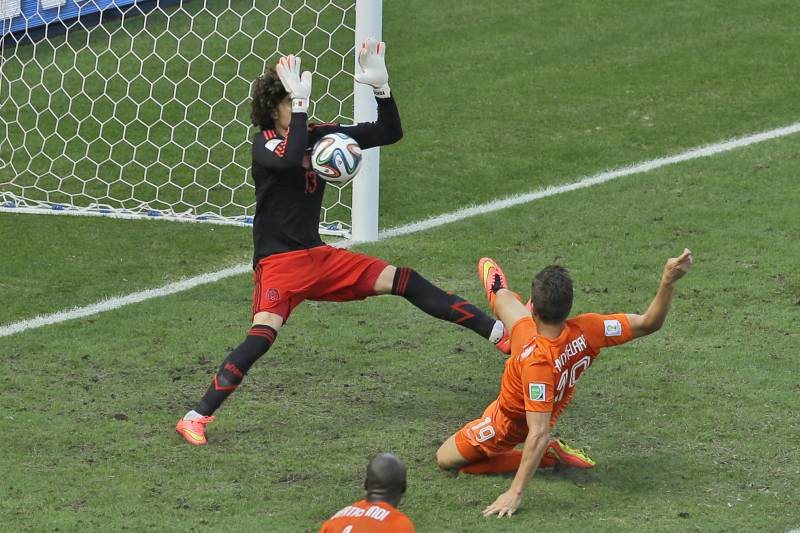 af287ff8a Mexico s goalkeeper Guillermo Ochoa makes a save after a shot by  Netherlands  Klaas-Jan
