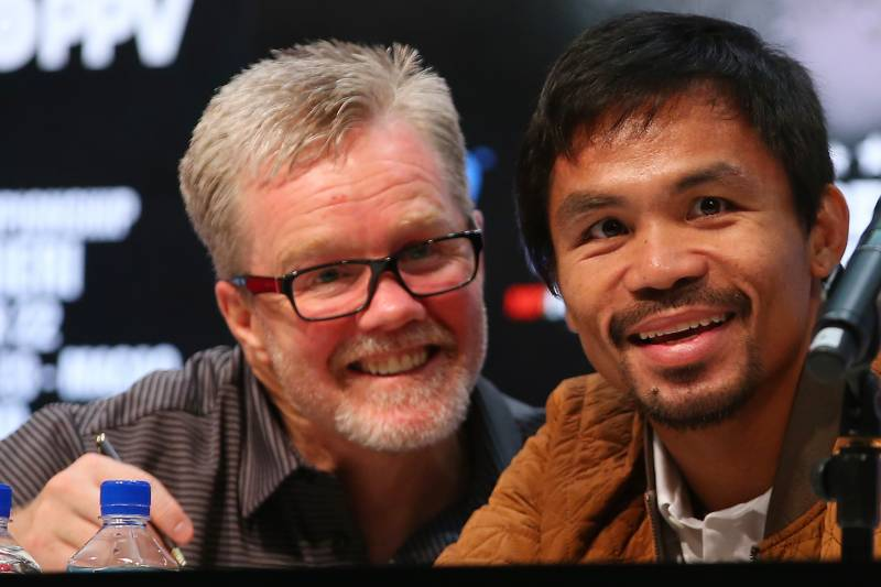 the latest 5314b a5bac MACAU - NOVEMBER 19  Manny Pacquiao and coach Freddie Roach talk during a  press conference