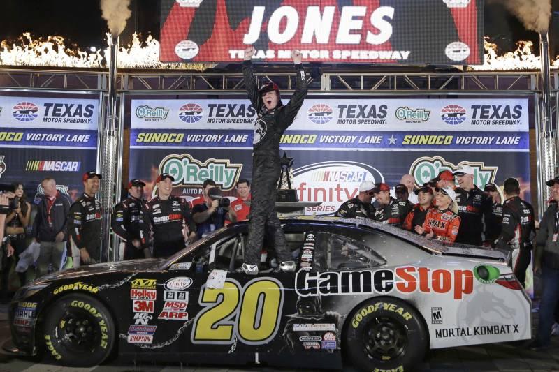 68f339f6cc42 Erik Jones (20) celebrates after winning the NASCAR Xfinity series auto race  at Texas
