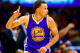 Golden State Warriors' Stephen Curry celebrates after scoring against the Los Angeles Clippers during the first half of an NBA basketball game, Tuesday, March 31, 2015, in Los Angeles. (AP Photo/Danny Moloshok)