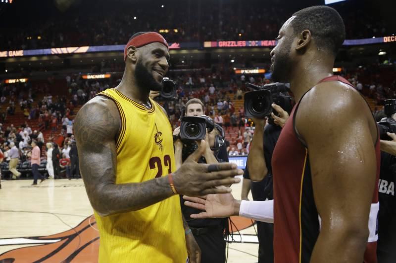 c66b551a1d66 Cleveland Cavaliers forward LeBron James (23) and Miami Heat guard Dwyane  Wade shakes hands