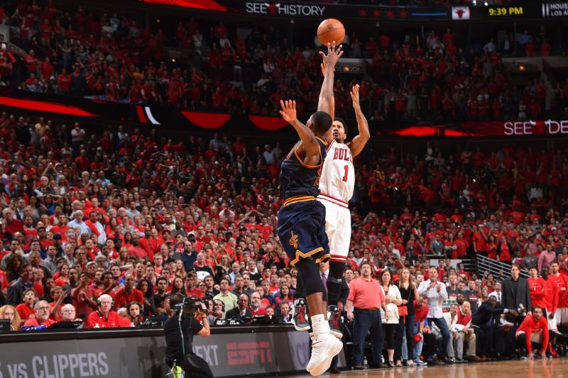 CHICAGO,IL : Derrick Rose #1 of the Chicago Bulls hits the game winning three pointer with three seconds left in the game against the Cleveland Cavaliers at the United Center During Game Two of the Eastern Conference Semifinals during the 2015 NBA Playoffs on May 8, 2015 in Chicago,Illinois NOTE TO USER: User expressly acknowledges and agrees that, by downloading and/or using this Photograph, user is consenting to the terms and conditions of the Getty Images License Agreement. Mandatory Copyright Notice: Copyright 2015 NBAE (Photo by Jesse D. Garrabrant/NBAE via Getty Images)