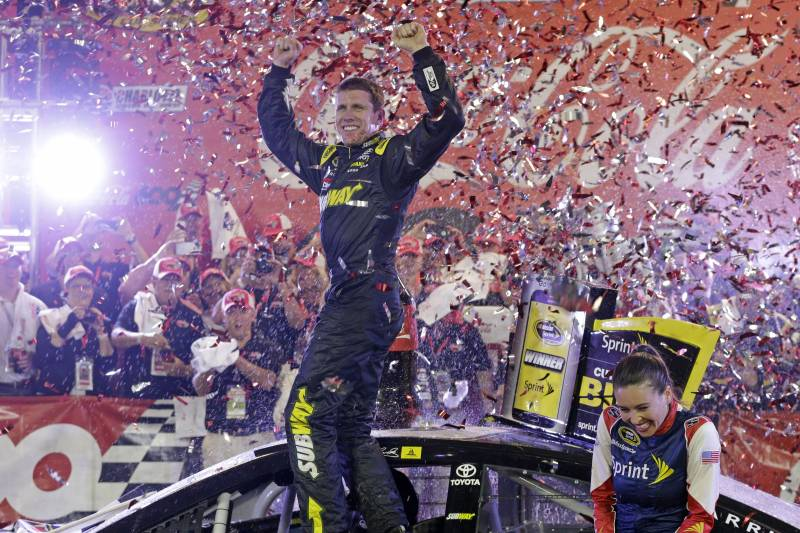 abc05c6957e8 Carl Edwards celebrates in Victory Lane after winning the NASCAR Sprint Cup  series auto race at