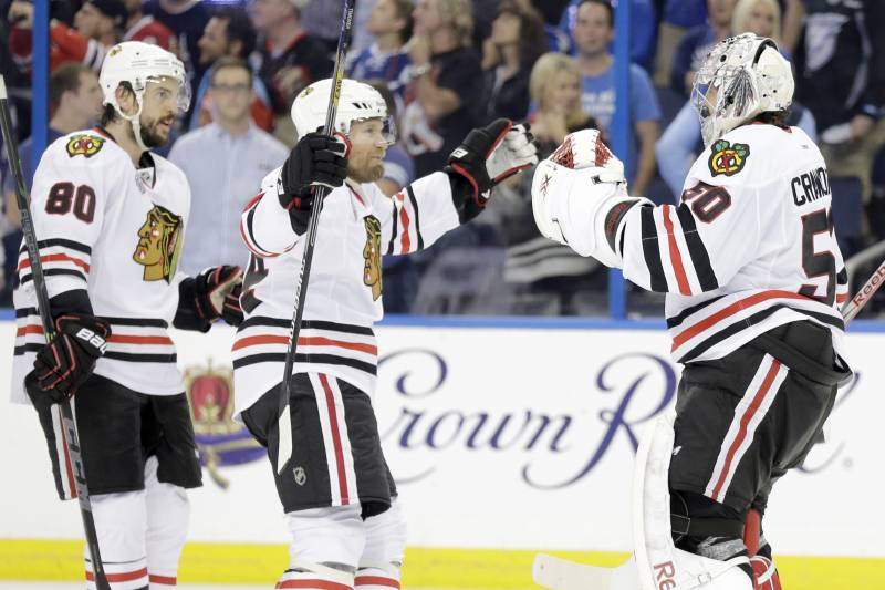 a6fa2465 Chicago Blackhawks goalie Corey Crawford (50) is congratulated by center  Antoine Vermette (80