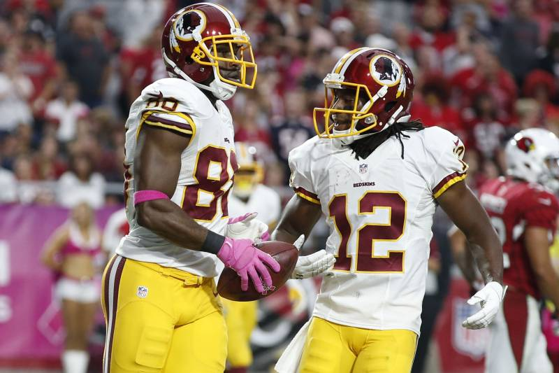 ab04ff3b2 Washington Redskins wide receiver Pierre Garcon (88) celebrate with Andre  Roberts (12)