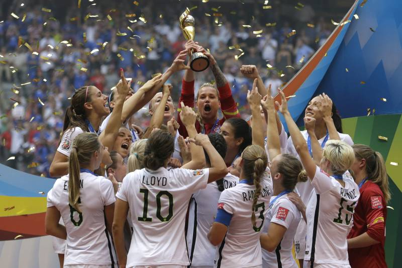 13435942c8b The United States Women s National Team celebrates with the trophy after  they beat Japan 5-