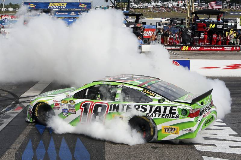 29ac93f50a81 Kyle Busch burns out after winning the NASCAR Sprint Cup series auto race  at New Hampshire