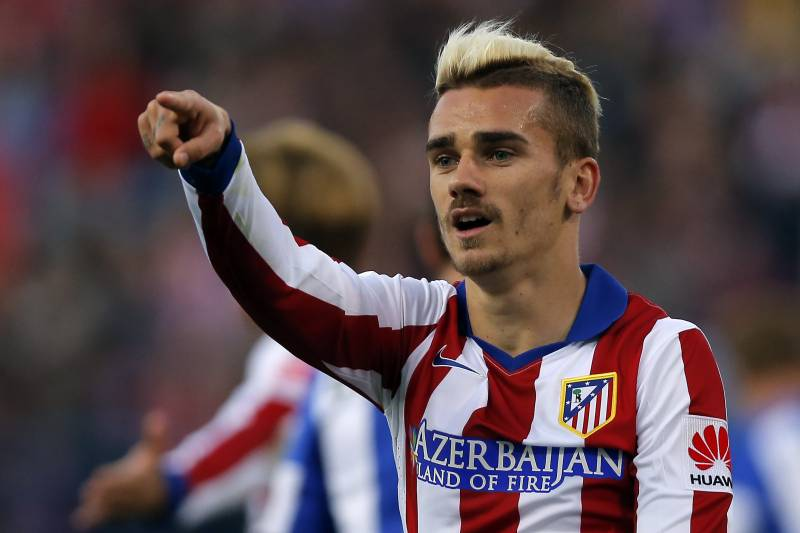 8758acfa2 Antoine Griezmann from France points during a Spanish La Liga soccer match  between Atletico de Madrid