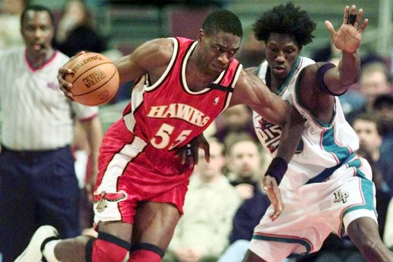 20c6c5a2ac6 Atlanta Hawks  Dikembe Mutombo (55) drives against Detroit Pistons  Ben  Wallace (