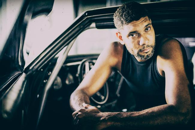 tim duncan revs up style in his car shop revealing a rare portrait