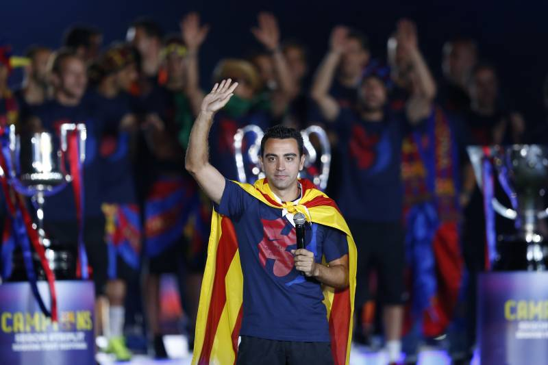 b39e4898928 Barcelona's Xavi Hernandez waves to the fans during celebrations at the  Camp Nou stadium in Barcelona