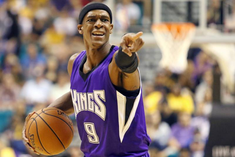 f6a68978d1d Sacramento Kings  Rajon Rondo gestures at a teammate during the first half  of an NBA