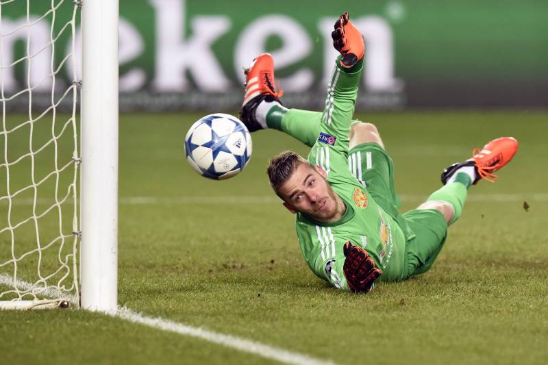 6d785f129ad Manchester United s Spanish goalkeeper David De Gea fails to stop a goal  during the UEFA Champions