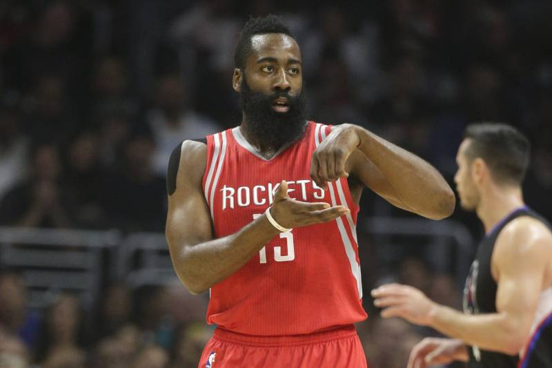 0f1a2342a2ee Houston Rockets  James Harden gestures after making a basket during the  first half of an