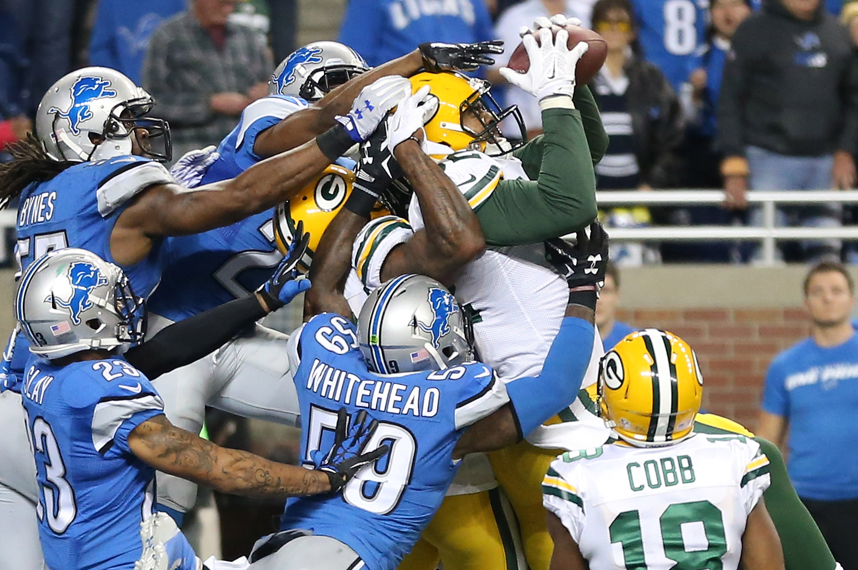 detailed look fecbc 37df6 Packers Beat Lions on Walk-Off 61-Yard Hail Mary After ...