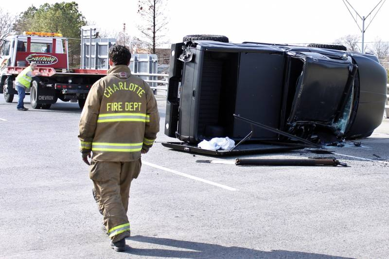 b6efafe8a69 A towing-operator works to upright the damaged truck driven by Carolina  Panthers quarterback Cam