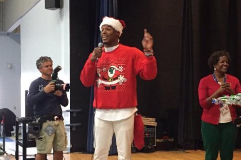 best sneakers bd23c f081b Cam Newton Surprises Local Kids in 'Dabbing Santa' Sweater ...