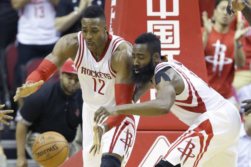 8ce2af523d0 Houston Rockets Dwight Howard (12) and James Harden go after a loose ball in