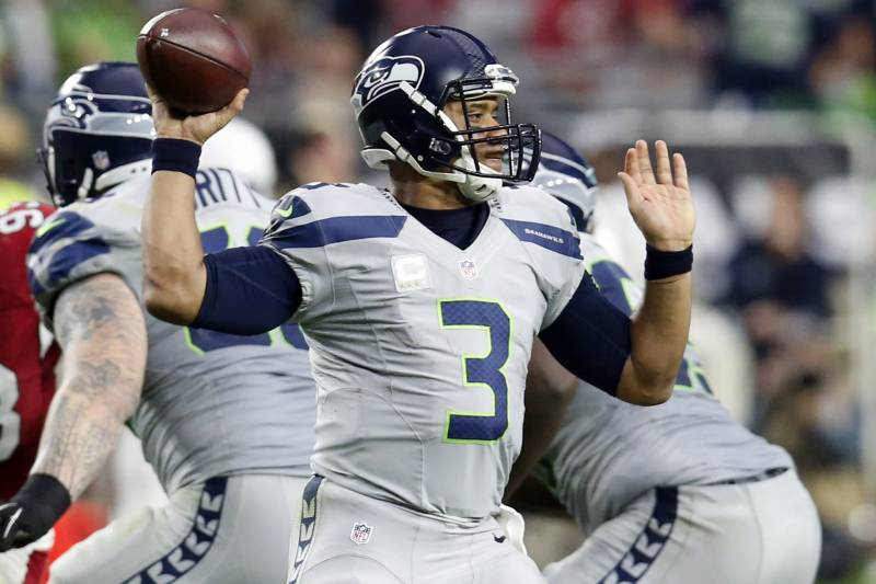 8083c775e Seattle Seahawks quarterback Russell Wilson (3) throws against the Arizona  Cardinals during the first