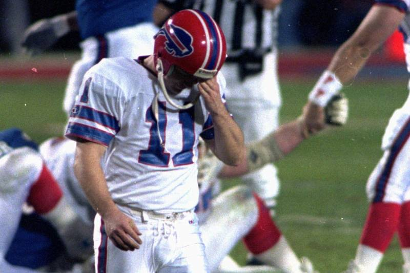 b7deb1e3912 Scott Norwood of the Buffalo Bills walks dejectedly off the field after  missing what would have