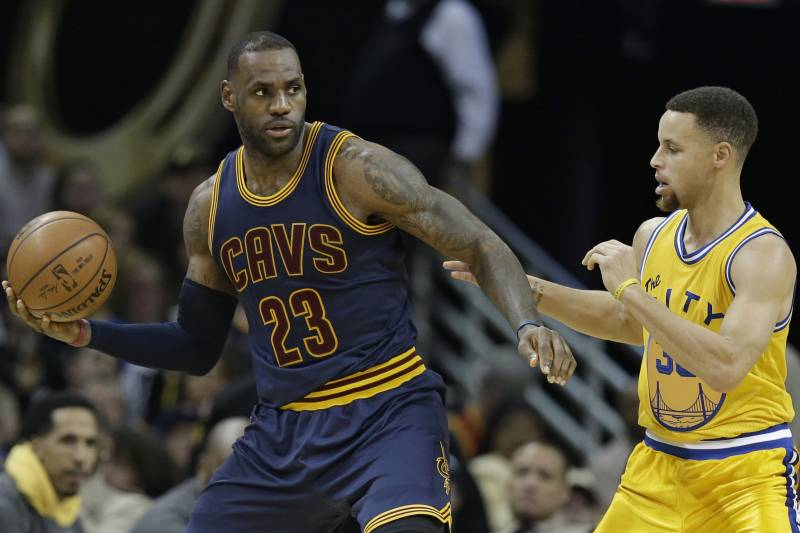 b7735029 Cleveland Cavaliers' LeBron James, left, drives past Golden State Warriors' Stephen  Curry