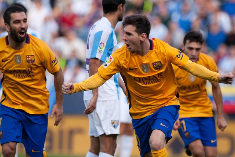 62deca7c4b6 Barcelona s Argentinian forward Lionel Messi celebrates after scoring  during the Spanish league football match Malaga CF