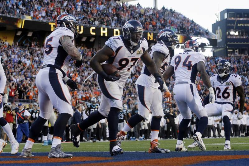 a43ac92c8ee Denver Broncos  Malik Jackson (97) celebrates after scoring a touchdown  during the first