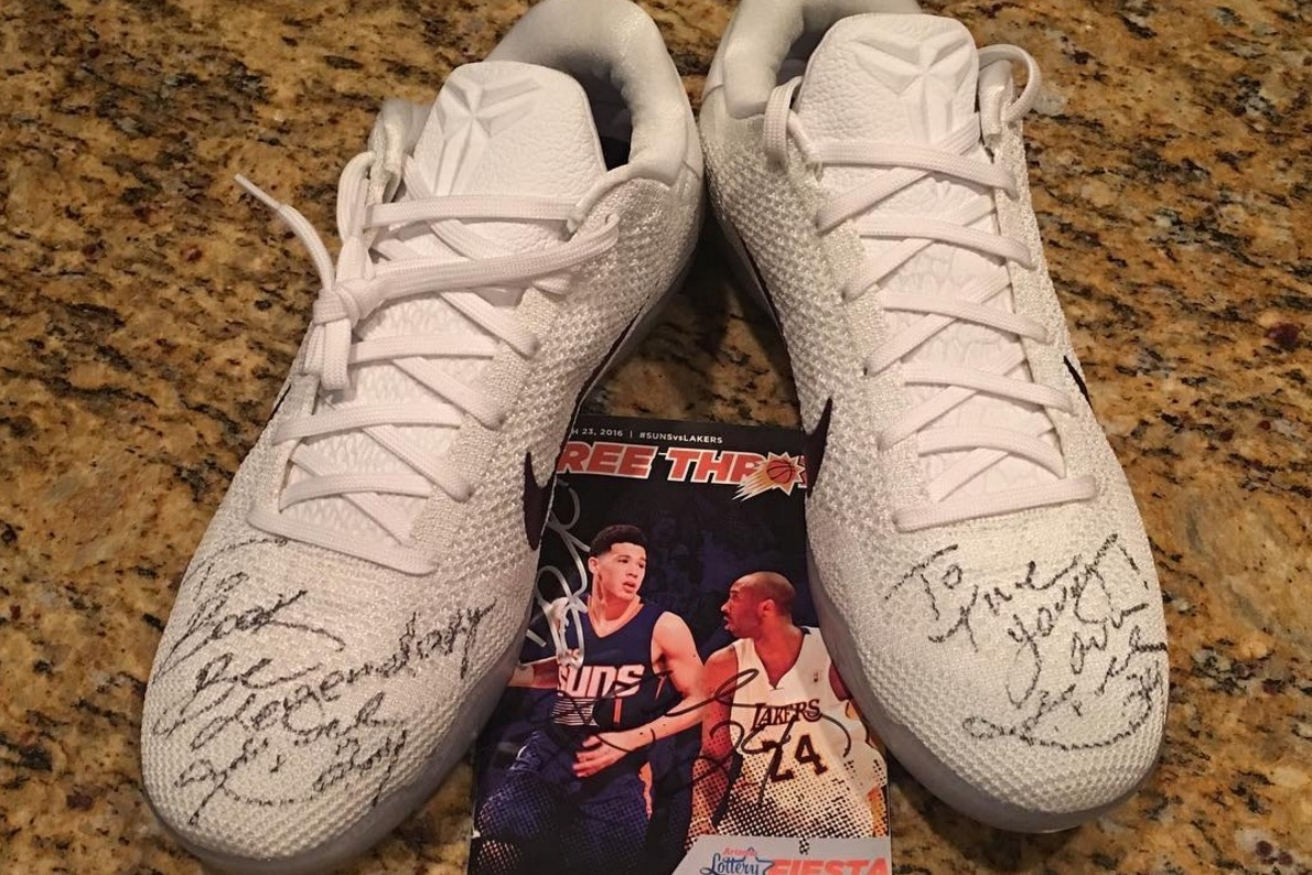 official photos b833e b252d Kobe Bryant Signs Shoes for Suns' Devin Booker, Tells Rookie ...