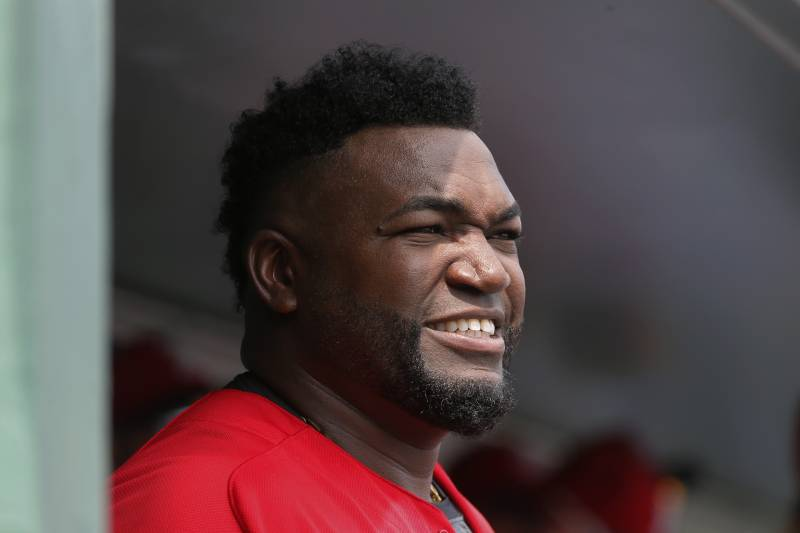 fa242d0723282 Boston Red Sox s David Ortiz stands in the dugout before an interleague  spring training baseball game