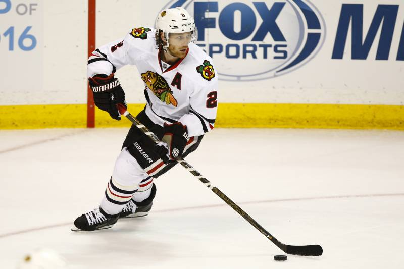 648bb95141b Chicago Blackhawks  Duncan Keith skates with the puck during an NHL hockey  game against the